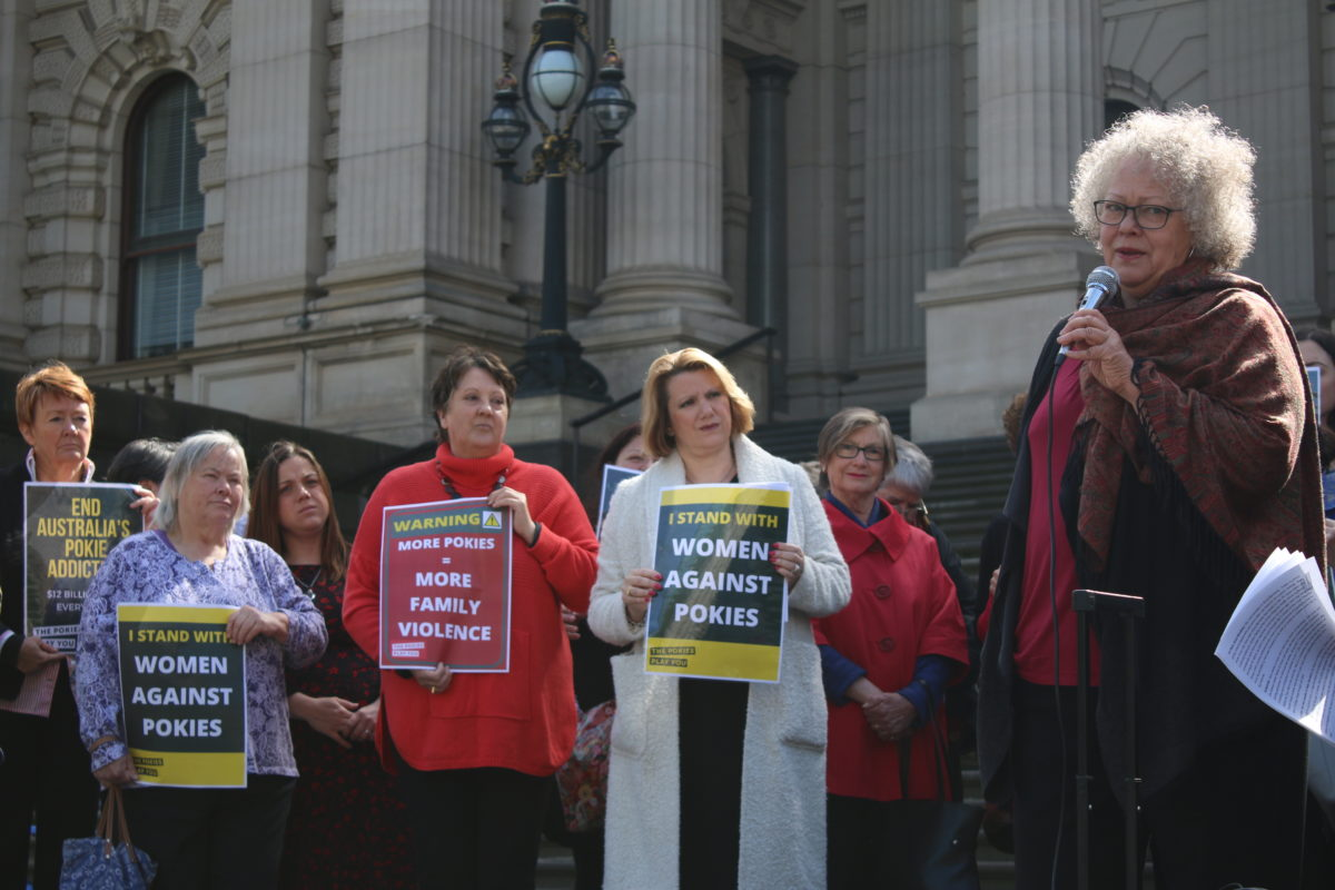 Photo: Former gambler Anna Bardsley addresses the Alliance for Gambling Reform (AGR) 'Women Against Pokies' rally on Parliament House steps in Melbourne on 31 October 2017.