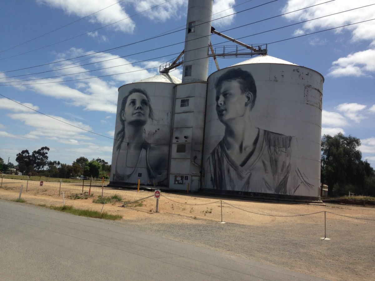 Photo: one of the silos on the Yarriambiack Silo Art trail. The Rupanyup silo mural by Russian Artist Julia Volchkova was inspired by the Rupanyup Panthers Football & Netball Club.