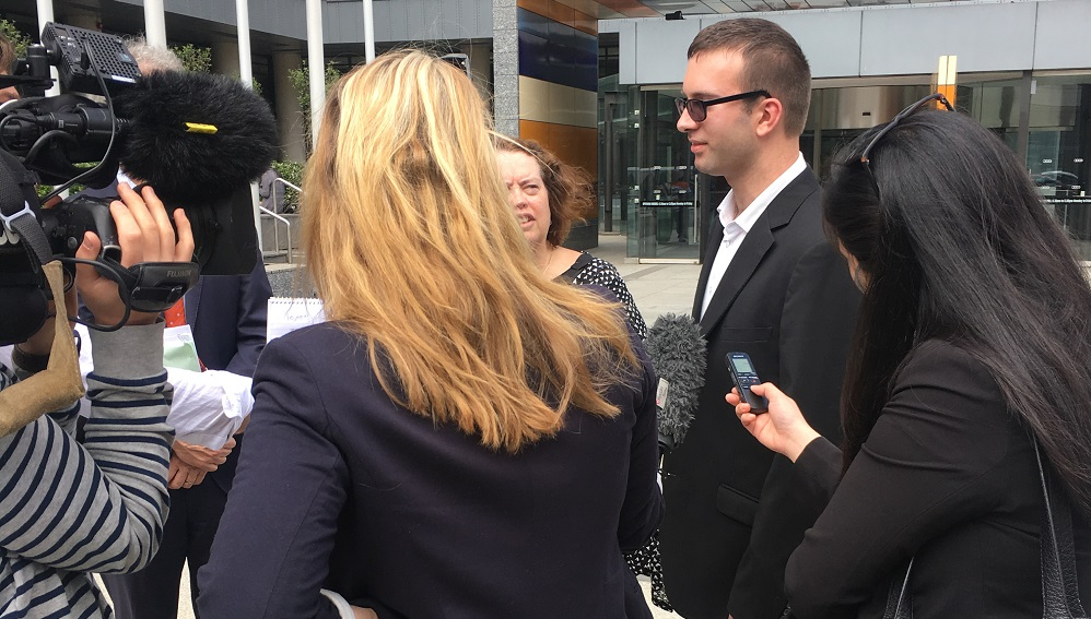 Photo: Chief litigant Tyson Duval-Comrie (with sunglasses) talks to the media outside the Federal Court after the decision in 2016.